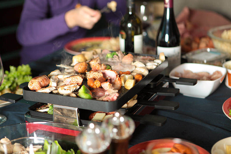 raclette party grill at dinner party